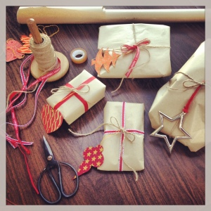 Brown paper is so simple, mix and match ribbon, use stickers and stamps too. Adding a Christmas decoration for a label is a nice keep sake.